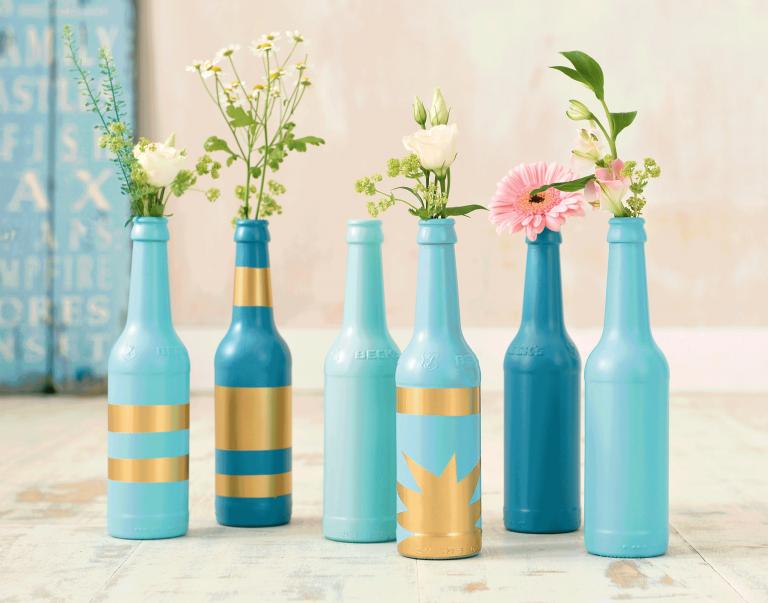 Flasche besprüht mit do it colorspray.