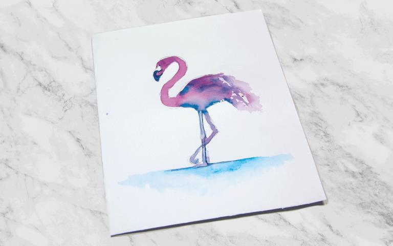 Eine Grußkarte mit einem Flamingo aus Aquarelltinte.