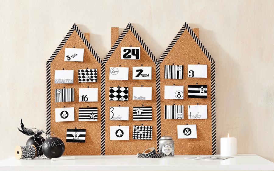 Ein Adventskalender in Form von 3 Häusern.
