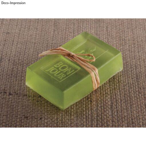 Transparente Seife in grün mit Bastschleife