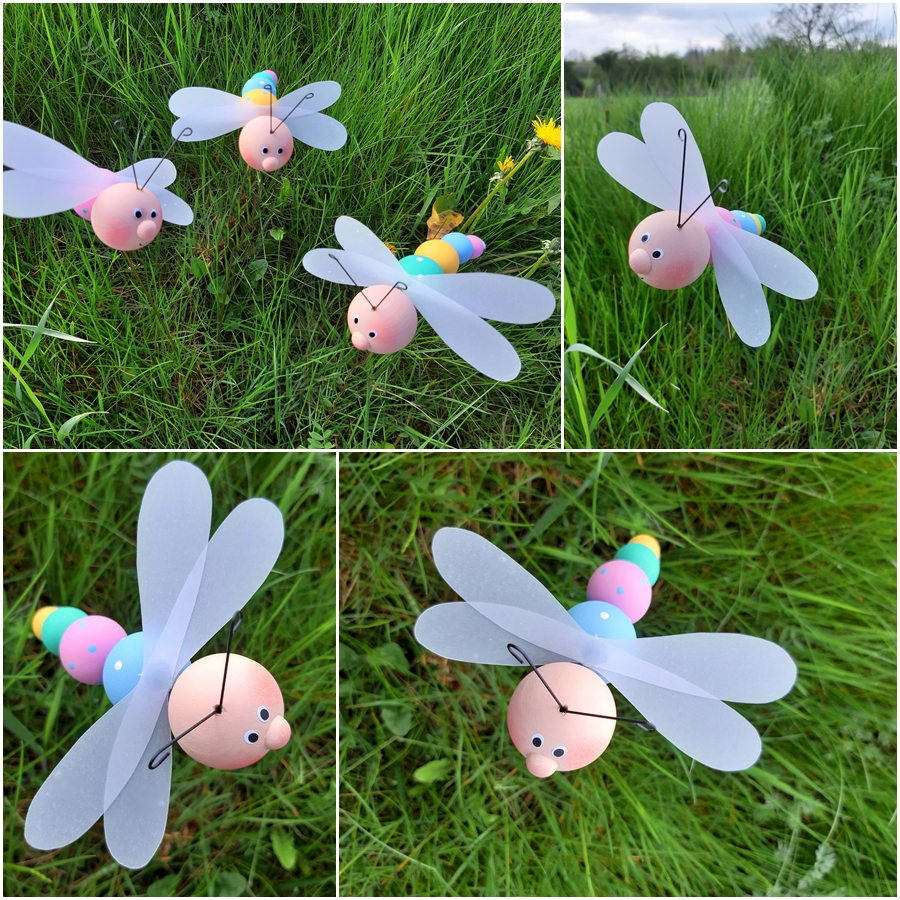 Libellen aus bunten Holzkugeln beim Fliegen